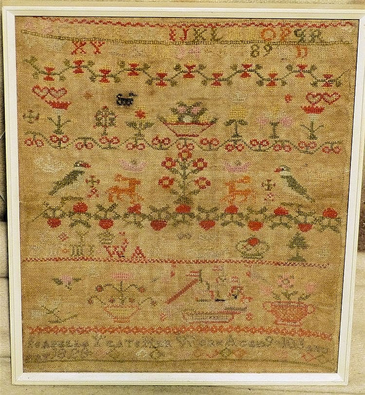 A 19th Century Small Sampler, having bird, vase, floral decoratio