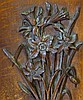 A Carved Oak Panel having raised bunch of flowers, 53cm x 27cm