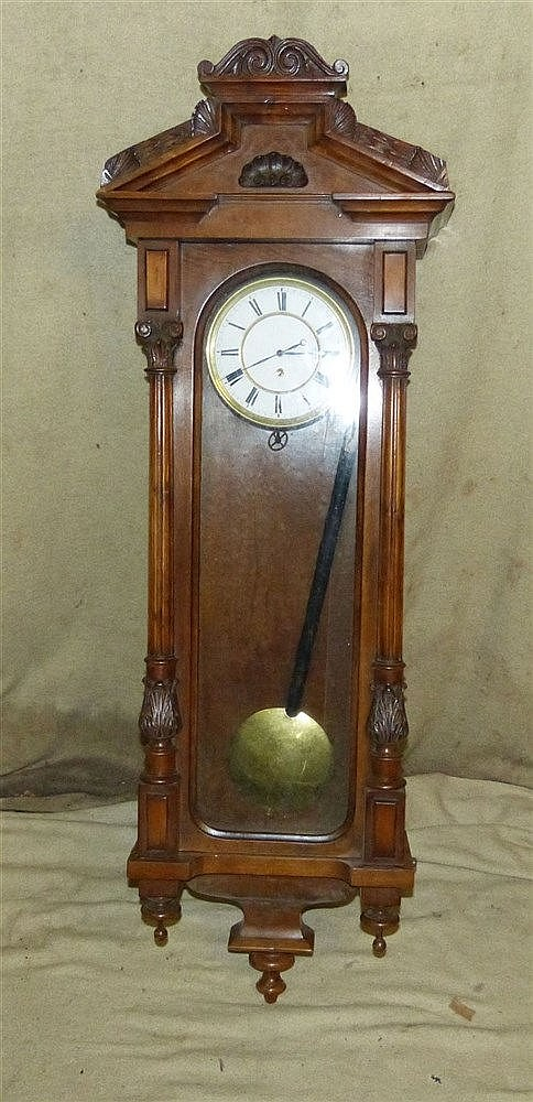 A 19th Century Walnut Vienna Hanging Wall Clock with carved raise