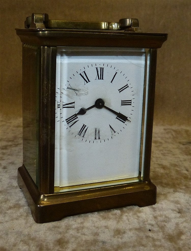 A Small Glass Carriage Clock having white enamel dial, with Roman