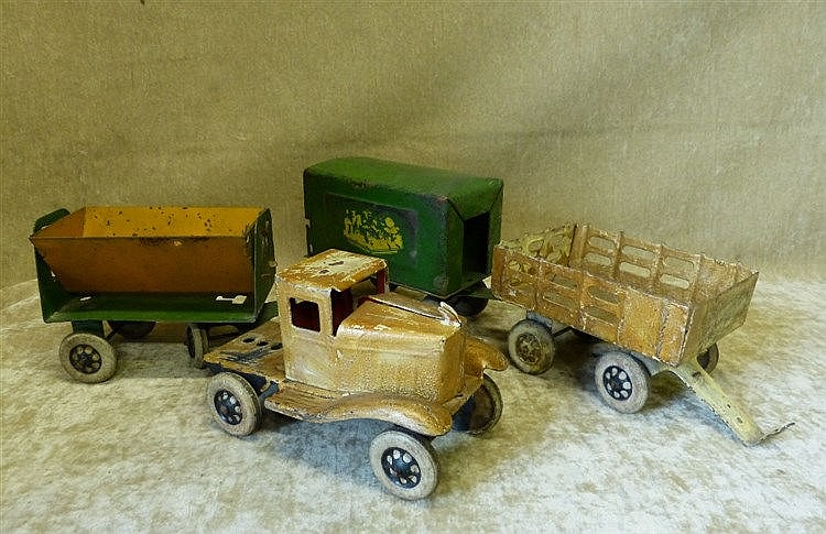 A Child's Tin Model of a Truck with 4 carriages, 72cm long overal