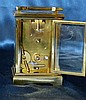 A Similar Brass Carriage Clock having chamfer corners, white enam