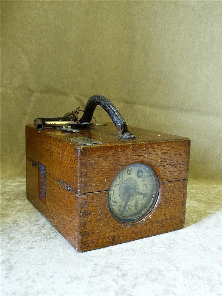 A Benzing Oak Pigeon Timer having Arabic numerals C.1924, 21.5cm