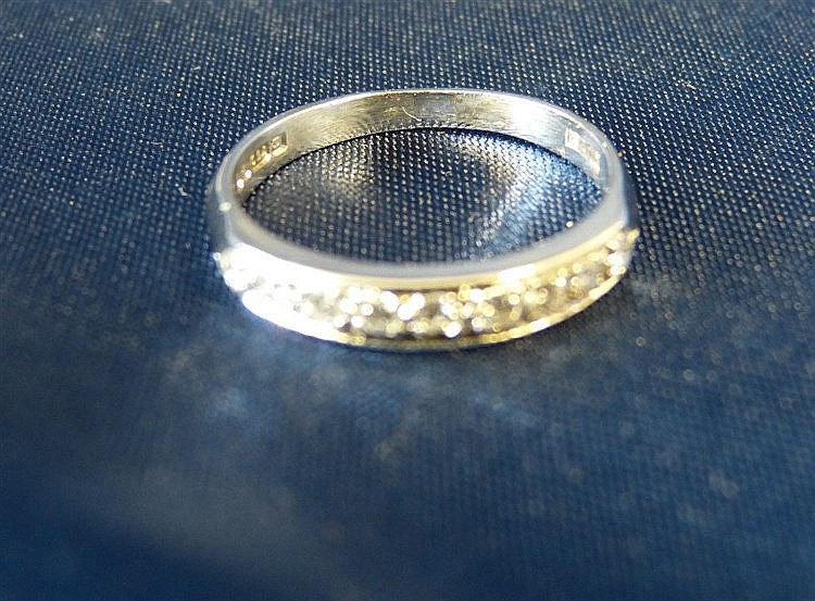 An 18ct White Gold Half Eternity Ring set with 9 diamonds