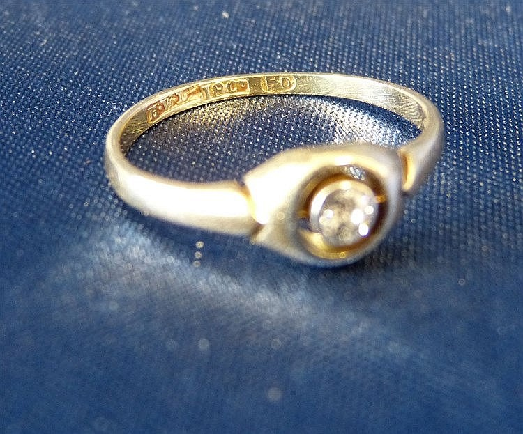 An 18ct Gold Small Solitaire Diamond Ring