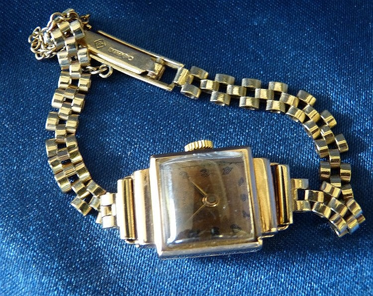 An 18ct Gold Sultans Square Faced Ladies Wrist Watch with Arabic