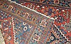 A Persian Carpet on red and blue ground having centre medallion,
