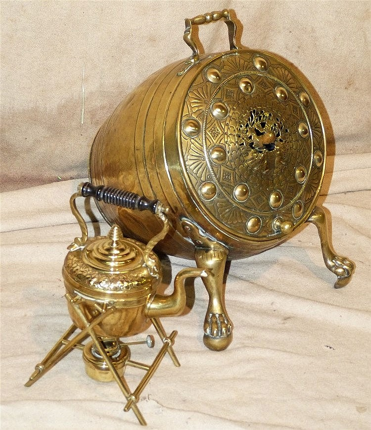 A Brass Barrel Shape Coal Bucket having hammered and pierced hing