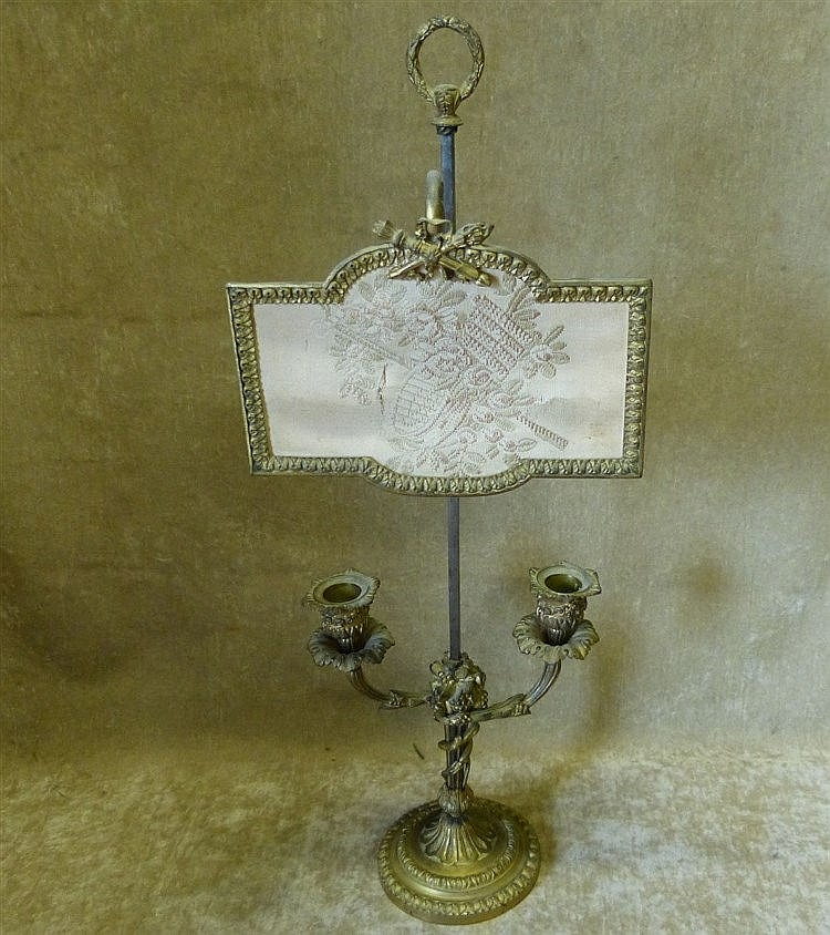 A 19th Century Gilt Metal Double Candlestick with adjustable Face