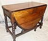 A 1920's Oak Oval Gate Leg Table on barley twist legs, 1m 48cm x