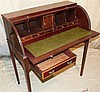 A Mahogany Roll Top Desk having tambour front enclosing leather w