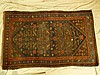 A Persian Rug on red, blue and brown ground, centre medallion wit
