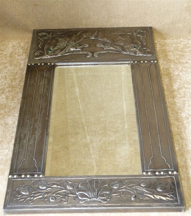 An Arts and Crafts Pewter Bevelled Hanging Wall Mirror with embos