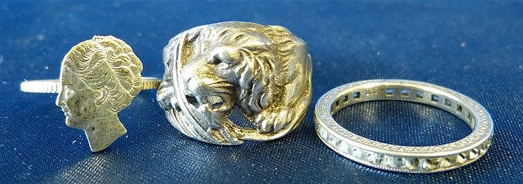 A Silver Ring having embossed and pierced lion motif, also 2 othe