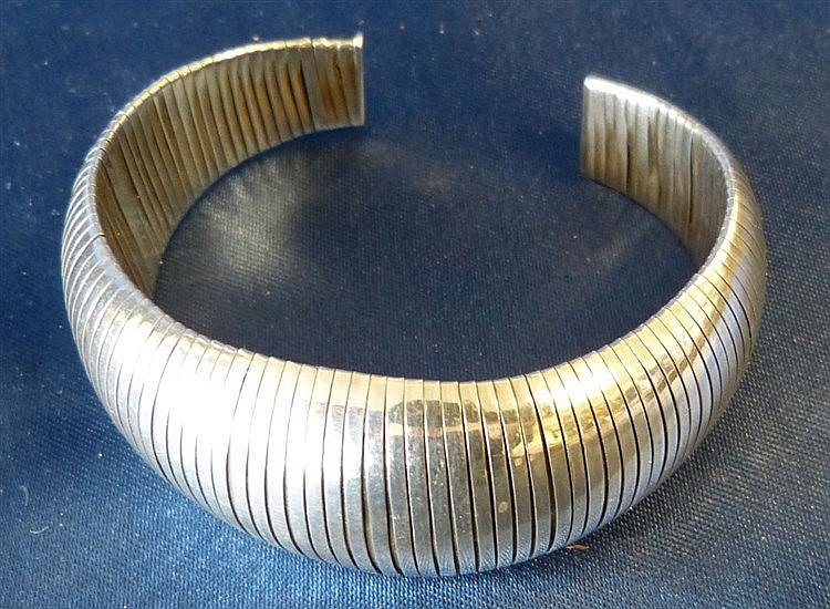 A 925 Silver Bulbous Shape Bangle having reeded decoration
