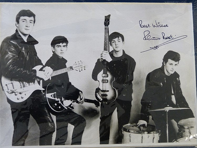 An Autographed Black and White Photograph signed