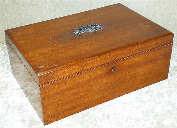 A Mahogany Rectangular Box having hinged lid enclosing inkwells a