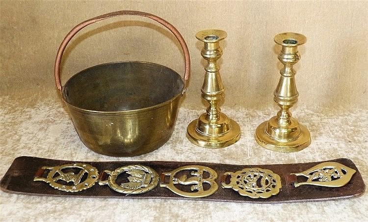 A Pair of Brass Candlesticks on turned stems with round sweeping