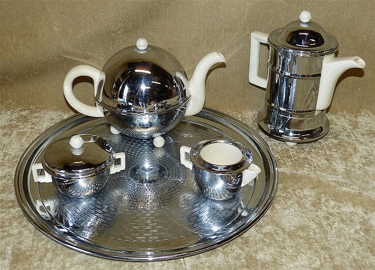 A Heatmaster Metal and China 5-Piece Tea Service Comprising round