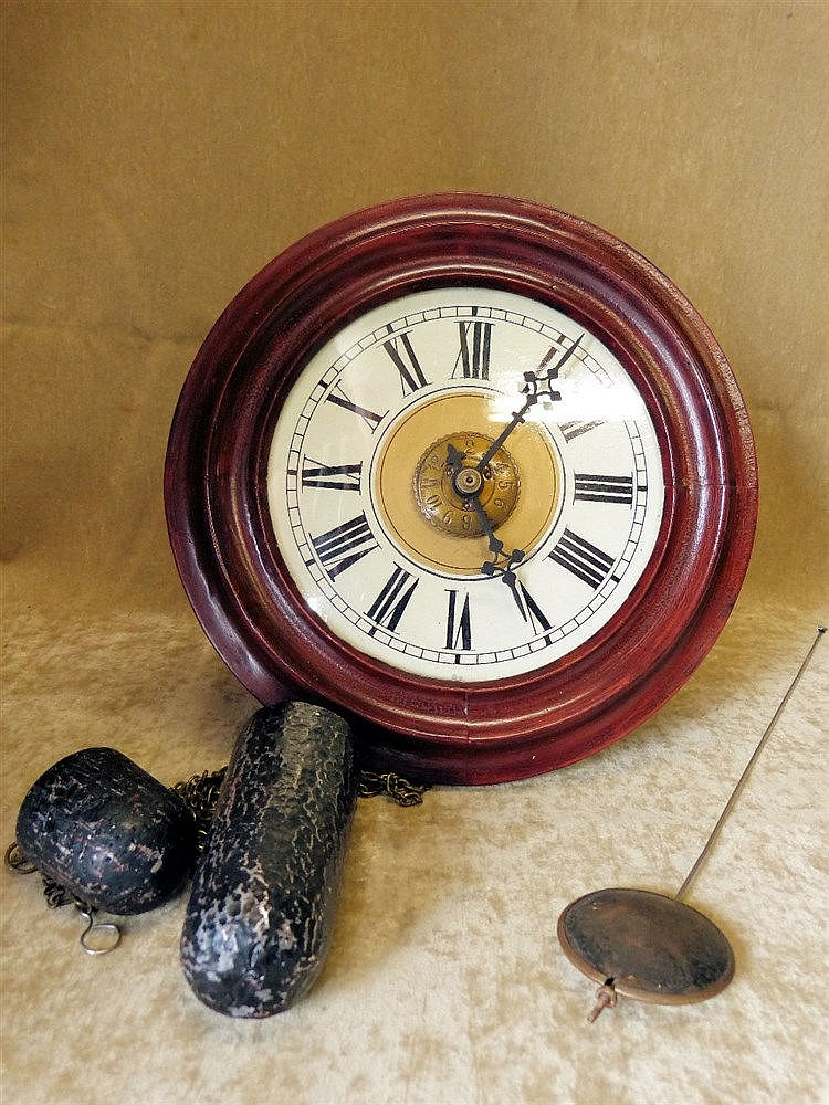 A Mahogany Hanging Alarm Wall Clock with cream dial and Roman num