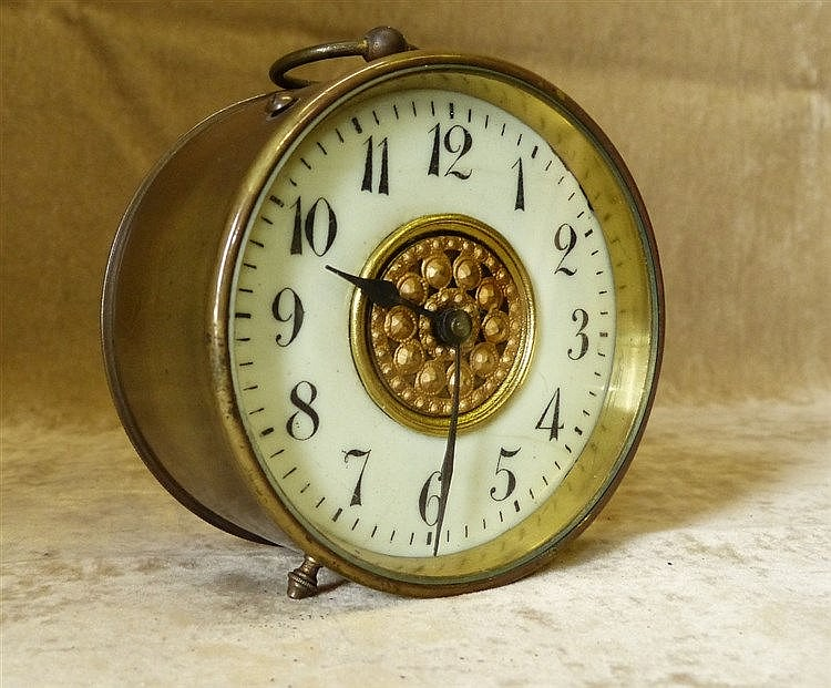 A Brass Drum Shape Timepiece having cream enamel chapter ring wit