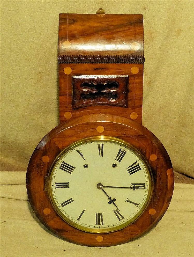 A Mahogany 8-Day Striking Hanging Wall Clock having round silvere