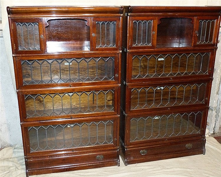 A Pair of Globe Wernicke Mahogany 4-Sectioned Bookcases, having l