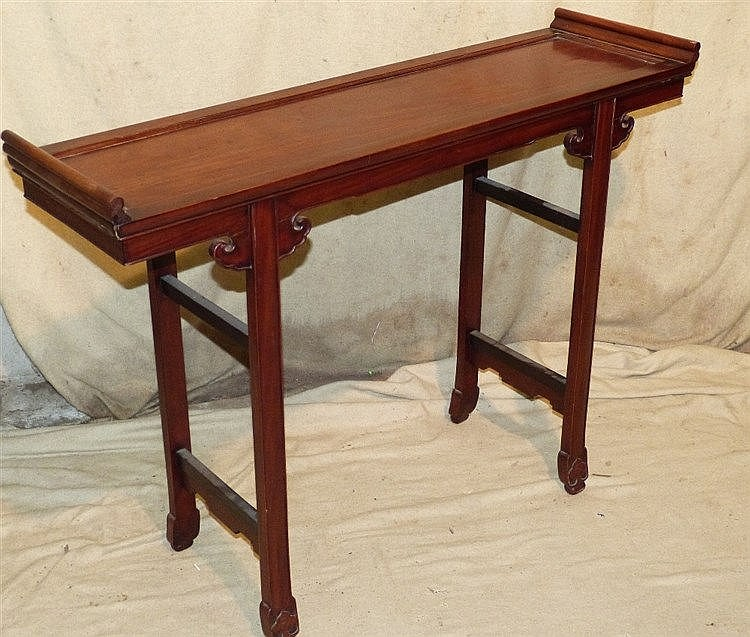 A 20th Century Oriental Alter Table having scroll ends on splayed