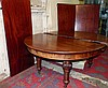 A Large 19th Century D-End Draw Leaf Dining Table having 3 extra