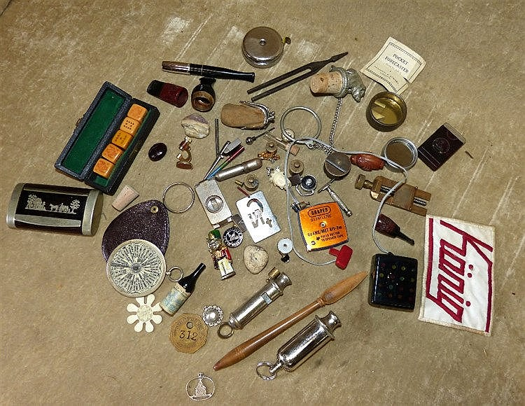 2 Whistles, a cigar holder and a quantity of various other items