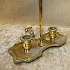 A Brass Double Chamber Candlestick having telescopic adjustable g