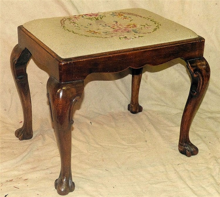 A Walnut Dressing Table Stool having needlework drop-in seat on c