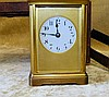 A Brass Repeat Half Striking Carriage Clock with round white enam