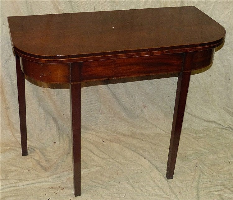 A 19th Century Mahogany Tea Table having inlaid banding with hing