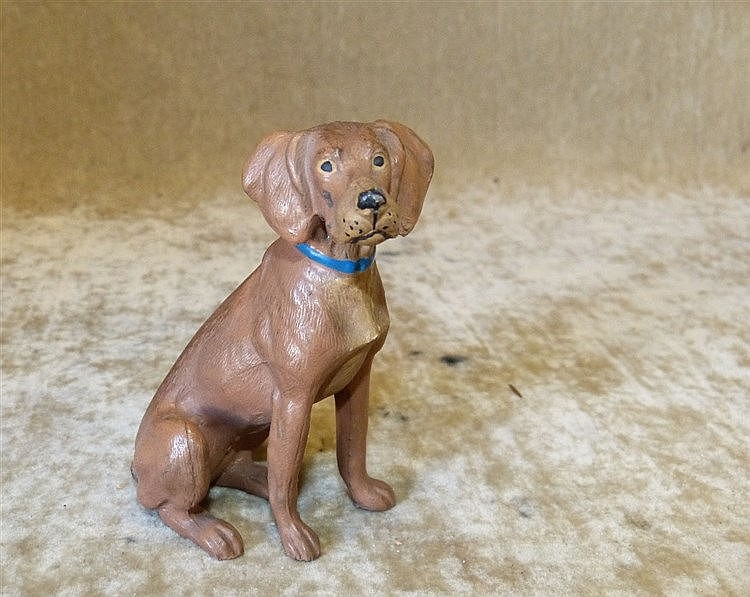 A Cold Painted Metal Figure of a seated dog (tail missing) 9cm hi