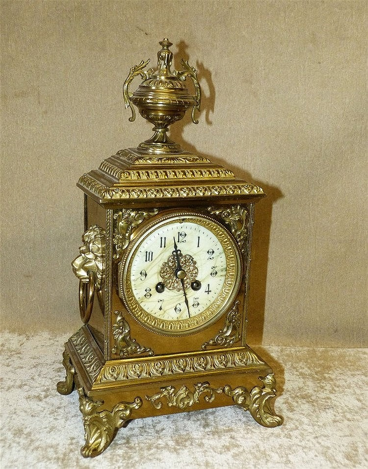 Japy Freres Gilt Metal 8 Day Striking Mantle Clock having urn mot