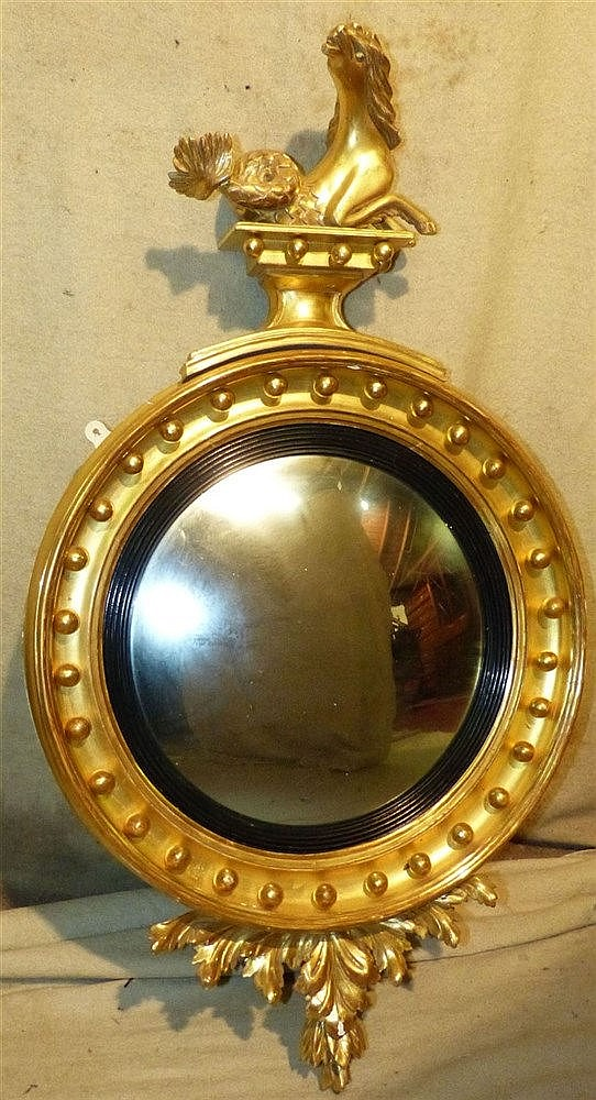 A 19th Century Gilt Hanging Convex Wall  Mirror having seahorse m