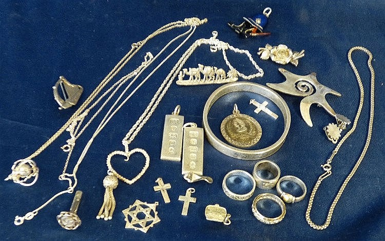 A Silver Bangle and a quantity of various silver rings, pendants,
