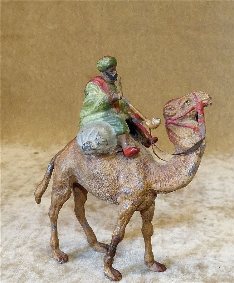 A Cold Painted Metal Figure of an Egyptian Gentleman riding a cam