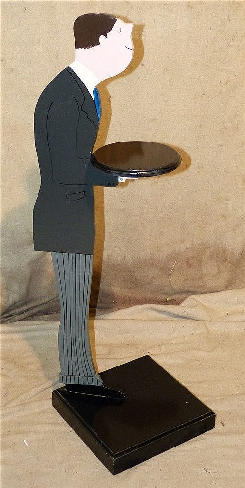 A Card Stand In Form of a Butler holding a tray on square base, 9