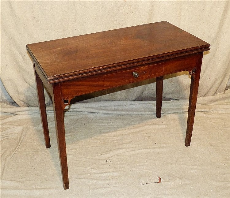 A 19th Century Mahogany Tea Table having hinged top, dummy drawer