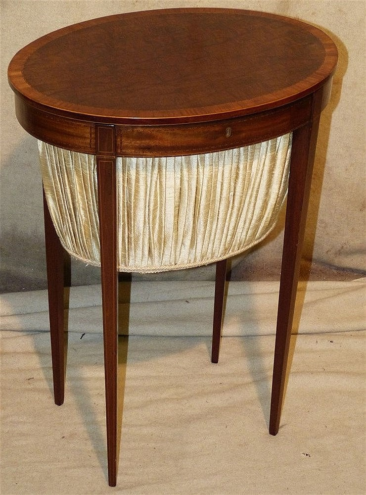 A 19th Century Mahogany Oval Worktable having banded and inlaid b