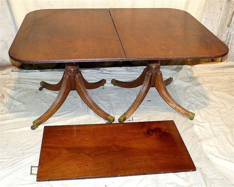 A Solid Mahogany D-End Double Pedestal Dining Table having 1 extr