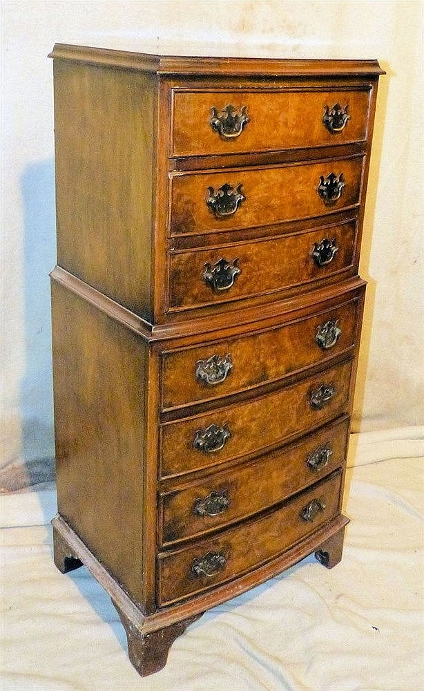 A Reproduction Walnut Small Chest on Chest having 3 long graduate