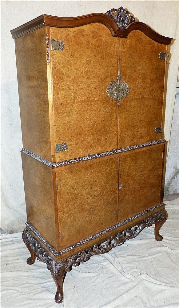 A Burr Walnut Queen Anne Style Cocktails Cabinet having carved sh