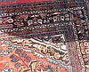 A Persian Carpet on red and blue ground having centre medallion (