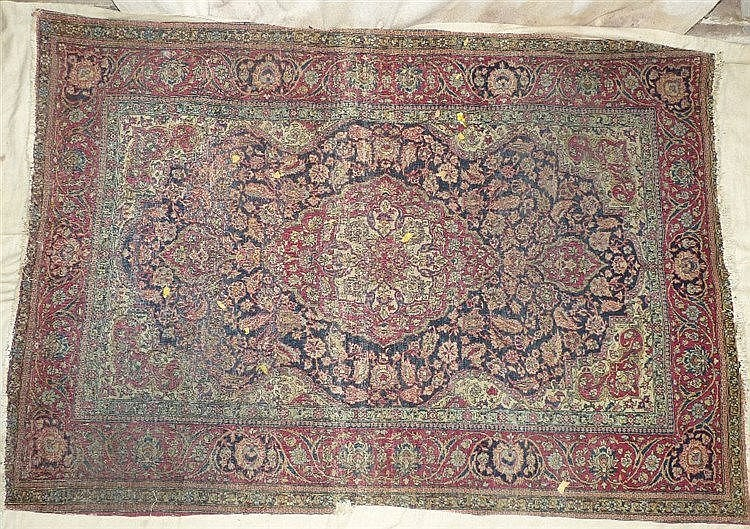 A Persian Rug on red and blue ground having centre medallion (wor