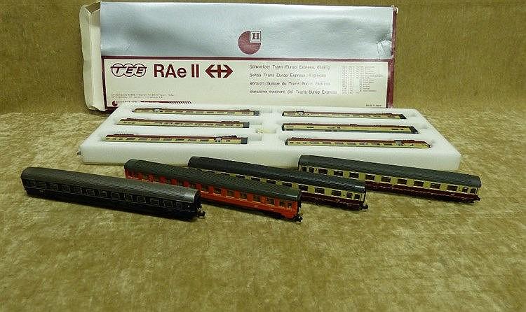 A Hobbytrain Tee Rae II Train Set, boxed and 4 similar loose carr