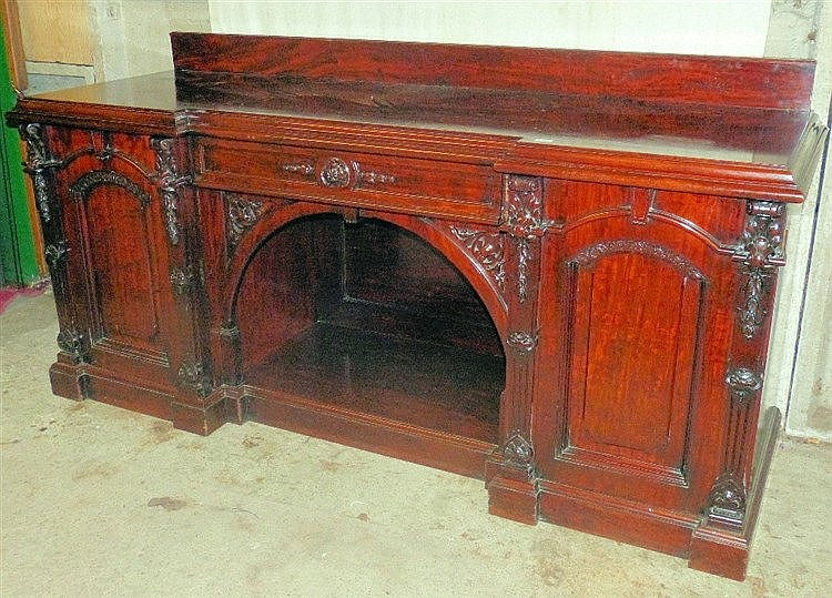 A Victorian Mahogany Sideboard having lipped back, centre drawer