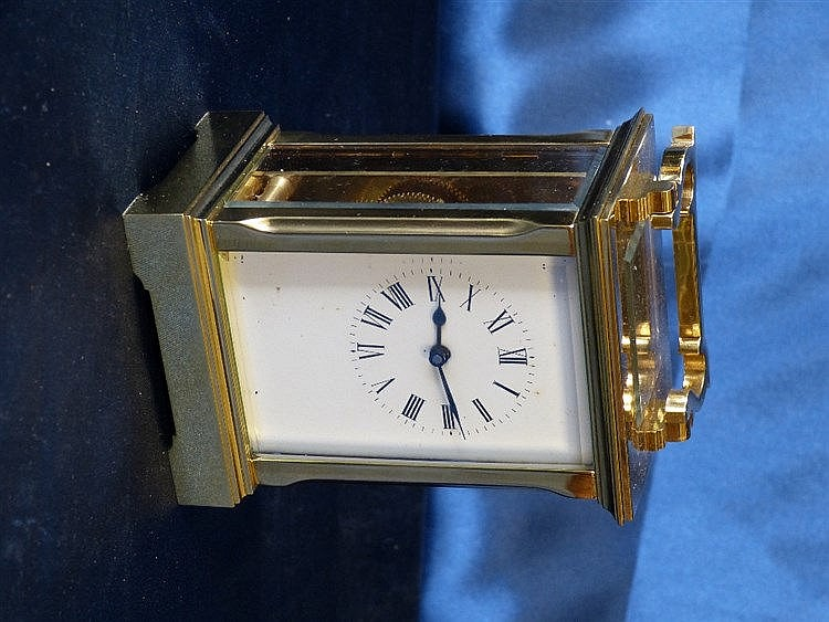A Brass Carriage Clock having chamfer corners, white enamel dial